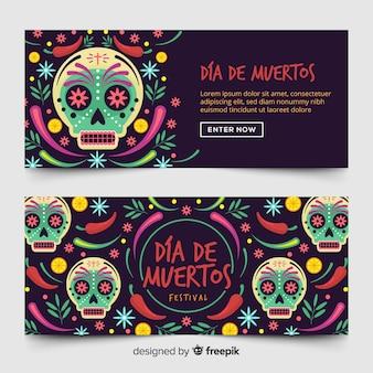 Día de muertos banner mit totenköpfen