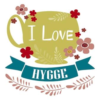Die aufschrift ich liebe hygge auf einer tasse mit einem getränk tee oder kaffee, umgeben von blumen vector