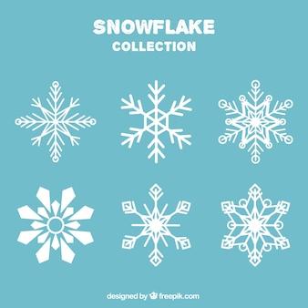 Die auswahl der schneeflocken in flachen stil