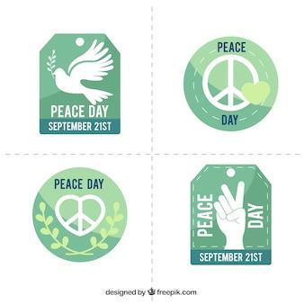 Die auswahl von abzeichen in den grünen tönen für den internationalen tag des friedens