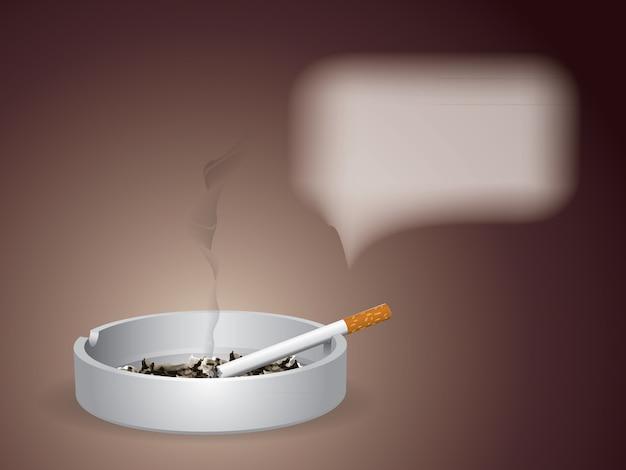 Die brennende zigarette ist auf dem aschenbecher