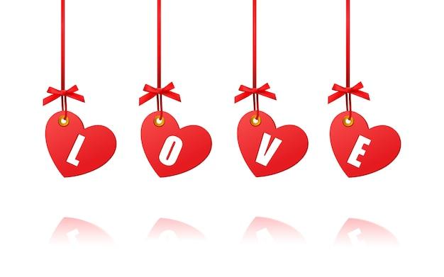 Die dekorativen herzen des valentinsgrußes auf weißem hintergrund