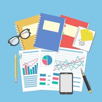 Die dokumente und grafiken auf dem desktop. konzept für geschäftsplanung und buchhaltung, analyse, finanzprüfung, seo-analyse, steuerprüfung, arbeit, management. brille, notebook, smartphone.