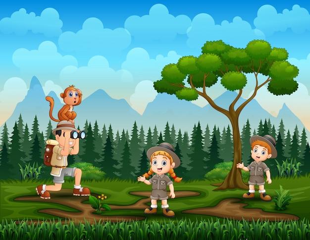Die entdeckerkinder im naturhintergrund