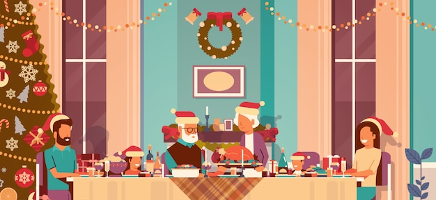 Die familie der multi generation, die feiertagsleute des neuen jahres sitzen bei tisch traditionelles abendessenkonzept feiert, verzierte horizontale innenebene des weihnachtsbaum-wohnzimmers