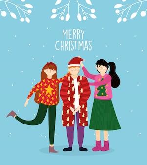 Die feierfamilie der frohen weihnachten, die hässliche strickjacke trägt, lässt schneedekoration