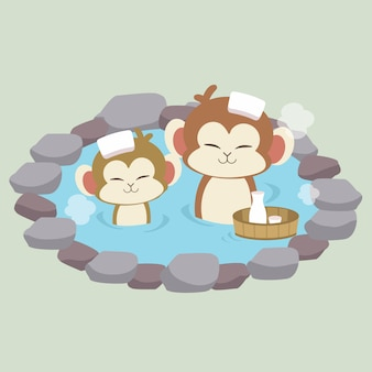 Die figur des niedlichen affen nimmt ein japanisches thermalbad