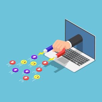 Die flache isometrische 3d-hand, die einen magneten hält, erschien vom laptop-monitor und zog social-media-symbole an. digitales marketing und social media-konzept.