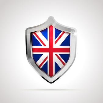 Die flagge des vereinigten königreichs wird als glänzender schild projiziert