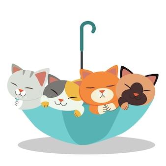 Die gruppe der süßen katze mit dem regenschirm. die katzen sehen glücklich und entspannend aus. der nette regenschirm und die nette katze in der flachen vektorart.