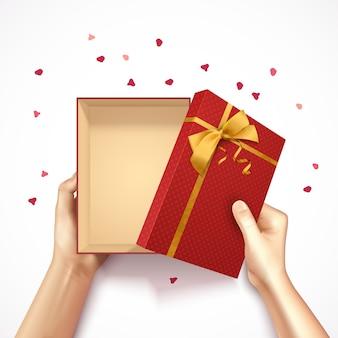 Die hände, die realistischen hintergrund 3d der geschenkbox draufsicht mit goldenem bogen des roten rechteckigen kastens und konfetti halten, vector illustration