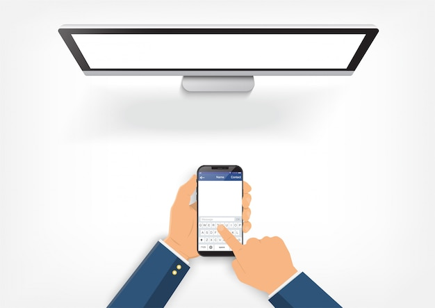 Die hände, die smartphone halten, sind an den computer angeschlossen.