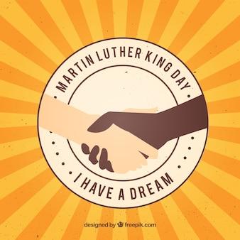 Die hände schütteln in martin luther king day hintergrund
