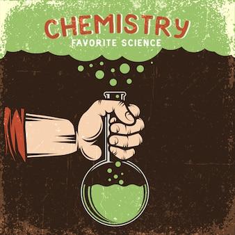 Die hand des mannes hält den chemischen kolben mit der grünen flüssigkeit