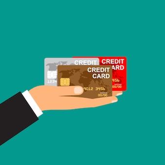 Die hand des mannes hält kreditkarten