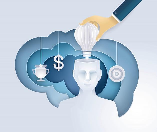 Die hand, die eine glühlampe in menschlichen kopf einsetzt, erhalten die idee und geben eine motivation, kreative ideen