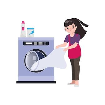 Die hausfrau wäscht die wäsche mit der waschmaschine.