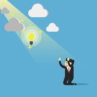 Die idee kommt vom geschäftsmann mit hellem licht wie ein engel.