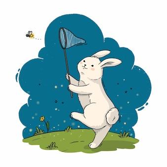 Die illustration eines niedlichen kaninchens mit einem schmetterlingsnetz fängt einen glühwürmchen