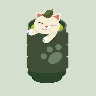 Die katze, die in der japanischen teeschale sitzt. der katzenblick entspannend mit der japanischen teeschale. die katze hat ein grünes teeblatt auf dem kopf.
