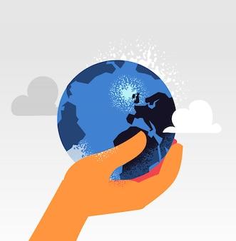 Die kontrolle des planeten erde in einer hand