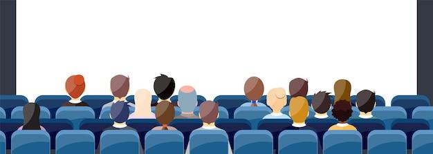 Die leute sitzen im kinosaal hinter der rückseite und suchen nach einem bildschirm mit textfreiraum