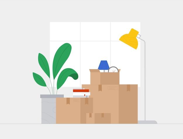 Die menschen zogen in ein neues zuhause und zogen in ein neues haus. papierboxen mit verschiedenen dingen - eine uhr, eine lampe, blumen.
