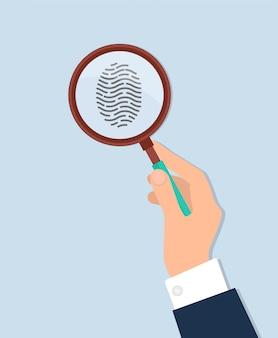 Die menschliche hand, die vergrößert, forschen fingerabdruck nach