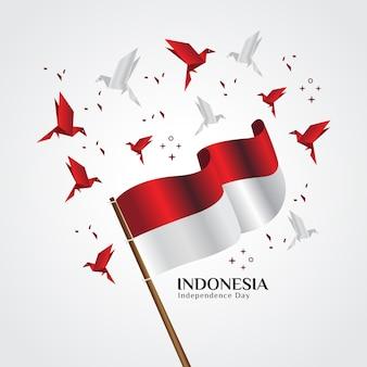 Die rote und weiße flagge, die indonesische staatsflagge, die mit origamivögeln fliegt
