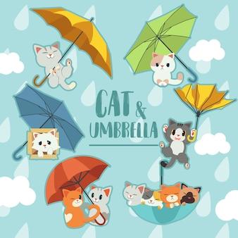 Die sammlung des regenschirms mit einem katzenset.