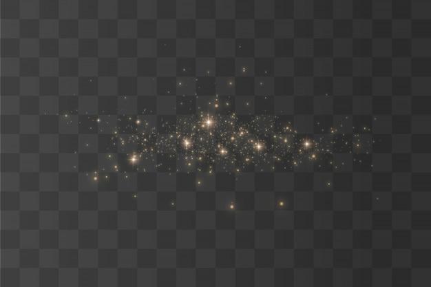 Die staubfunken und goldenen sterne leuchten mit besonderem licht. funkelnde magische staubpartikel. funkelt auf einem transparenten hintergrund. weihnachtslichteffekt.