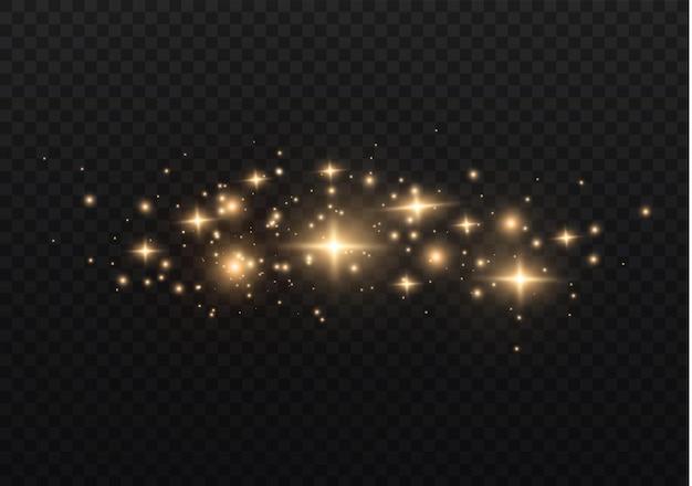Die staubfunken und goldenen sterne leuchten mit besonderem licht. funkelt auf einem transparenten hintergrund. weihnachtslichteffekt.