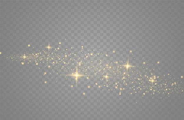 Die staubfunken und goldenen sterne leuchten mit besonderem licht. vektor funkelt auf einem transparenten hintergrund. weihnachtslichteffekt. funkelnde magische staubpartikel.