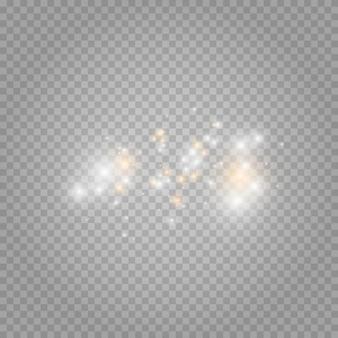 Die staubfunken und goldenen sterne leuchten mit besonderem licht