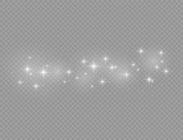 Die weißen staubfunken und der stern leuchten mit besonderem licht, weihnachtsglanz-lichteffekt, funkeln, glanzlichtern, funkelnden magischen staubpartikeln, die auf transparentem hintergrund isoliert sind.