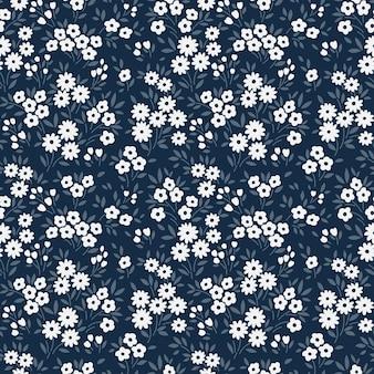 Ditsy vektor blumenmuster nahtloser druck kleine weiße blumen dunkelblauer hintergrund