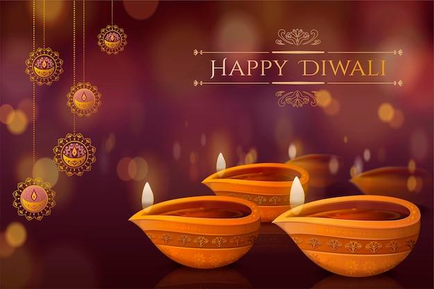 Diwali-festival-design mit diya und hängenden dekorationen auf bokeh-hintergrund