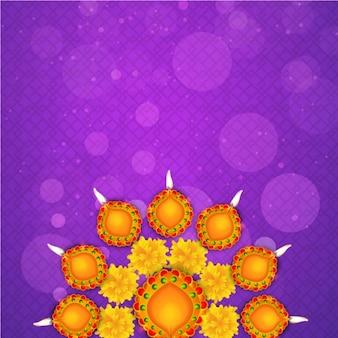 Diwali hintergrund mit kerzen und gelben blüten