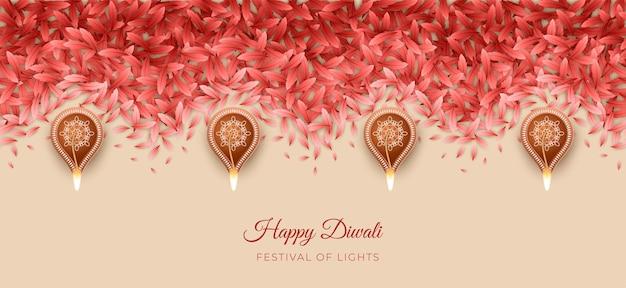 Diwali- oder pongal-festival-rangoli-muster aus blütenblättern und brennenden diya-lampen