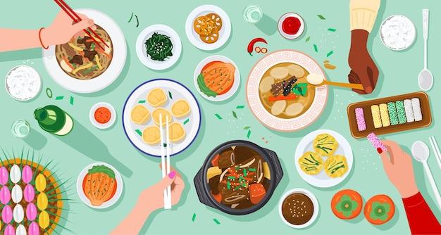 Draufsicht der leute, die koreanisches essen zusammen genießen