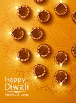 Draufsicht des diwali-designs mit öllampen-rangoli auf chromgelbem hintergrund