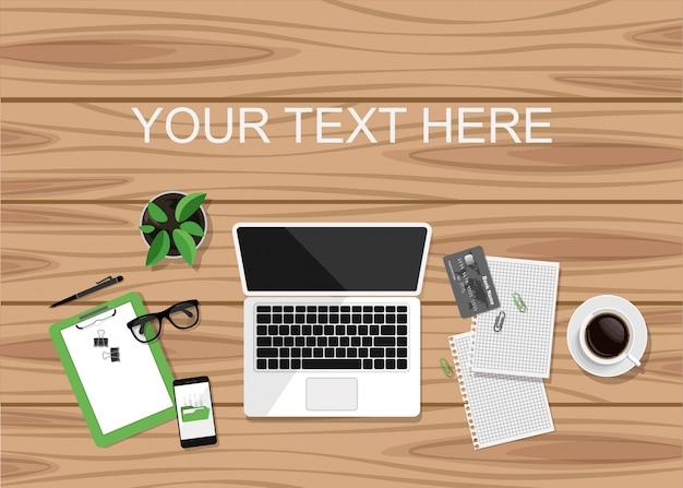 Draufsicht des geschäftsarbeitsplatzes auf holzschreibtisch und kopierraum für ihren text.