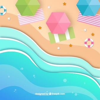 Draufsicht des strandes mit origamiart