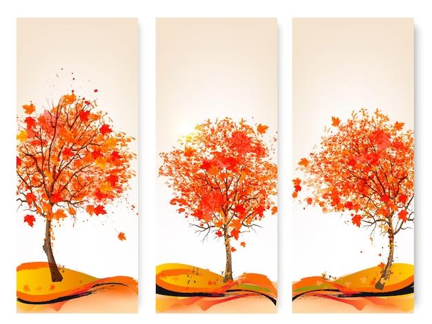 Drei abstrakte herbstfahnen mit bunten blättern und bäumen. illustration.