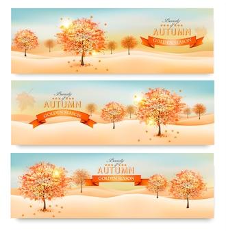 Drei abstrakte herbstfahnen mit bunten blättern und bäumen.