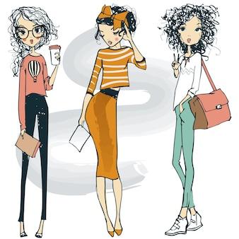 Drei cartoon niedliche mode skizziert hipster-mädchen