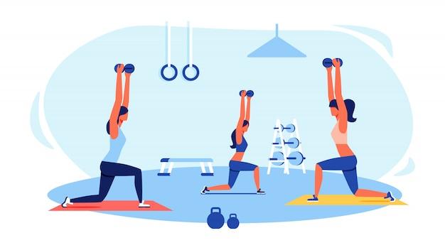 Drei frauen in trainingsanzügen, die übungen in der turnhalle tun