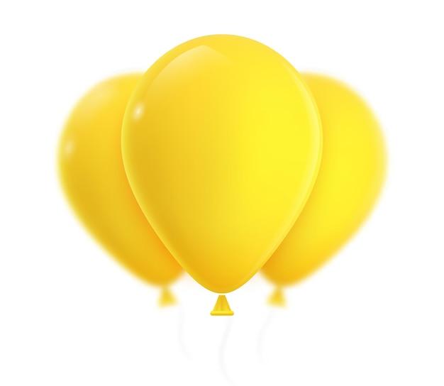 Drei gelbe heliumballons.