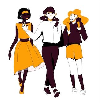Drei junge freundinnen gehen spazieren und plaudern und haben spaß studenten in trendigen farben