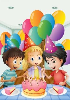 Drei kinder, die einen geburtstag feiern